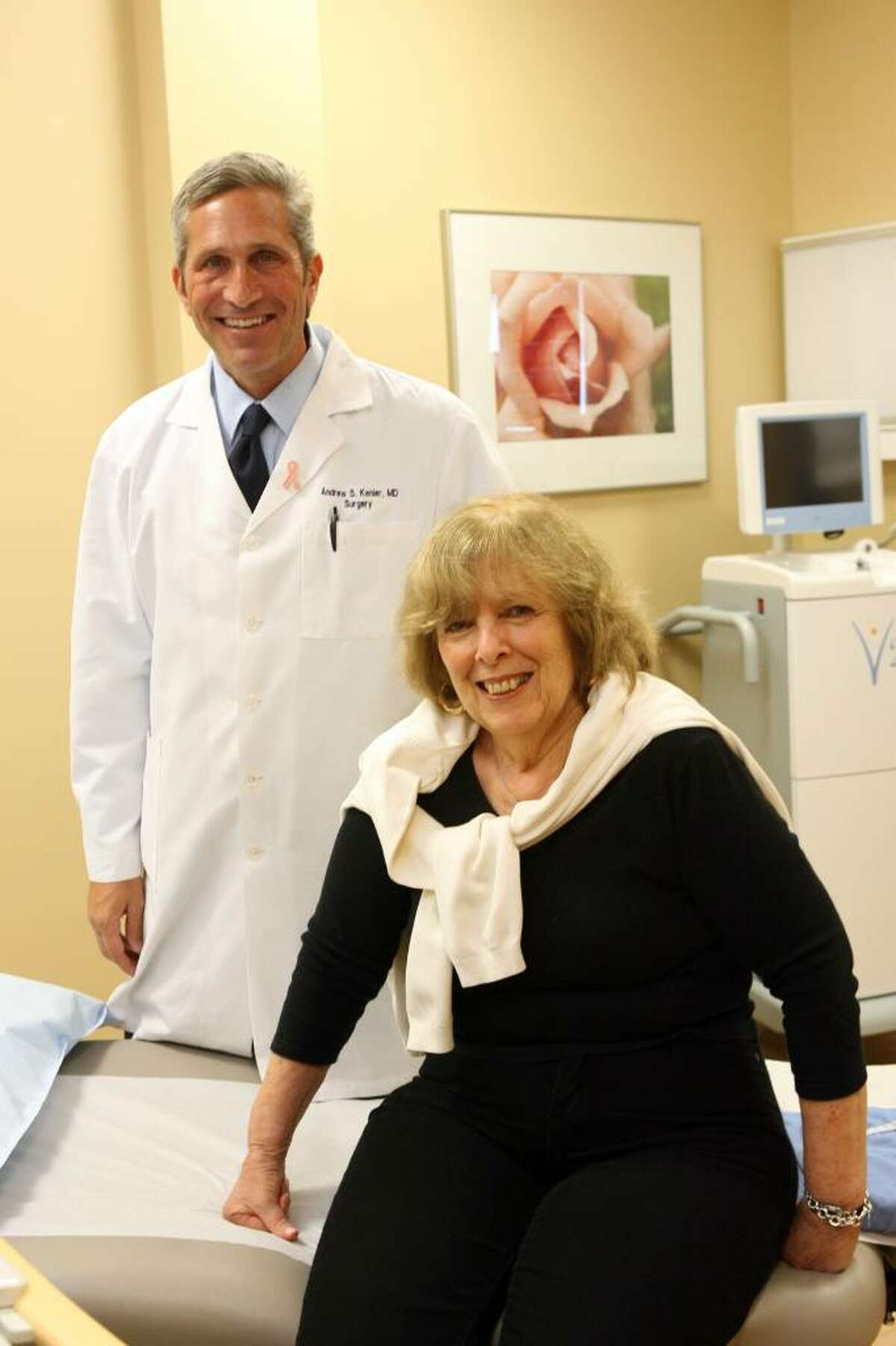 Dr Andrew Kenler stands in his Trumbull office with his patient, Judith Kudikoff of Bridgeport. Kenler ran a trial for a new treatment for breast cancer, which successfully treated Kudikoff.