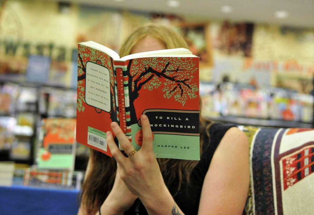Barnes & Noble employee Katelyn Neff reads a chapter from Harper Lee's novel, ?