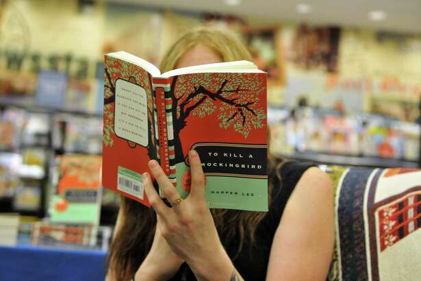 "Barnes & Noble employee Katelyn Neff reads a chapter from Harper Lee's novel, ""To Kill a Mockingbird,"" during the ""To Kill a Mockingbird"" Read-a-Thon Monday, July 13, 2015, at Colonie Center Barnes & Noble Booksellers in Colonie, N.Y. (Phoebe Sheehan/Special to The Times Union)"