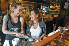 Waitress Aliss Szumowski, left, and bartender Missy Vavala at the Tipsy Moose on Old Loudon Road Tuesday Feb 21, 2017 in Colonie, NY.  (John Carl D'Annibale / Times Union)
