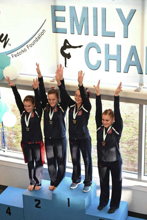 Darien YMCA Level 9 gymnasts on the podium for vault at the Emily Fedorko Challenge were Kelsey Fedorko and Jessica Freiheit in a second place tie. Gianna Cardini, first, and Nikki Carlo, third. Photo: Contributed Photo / Darien News contributed