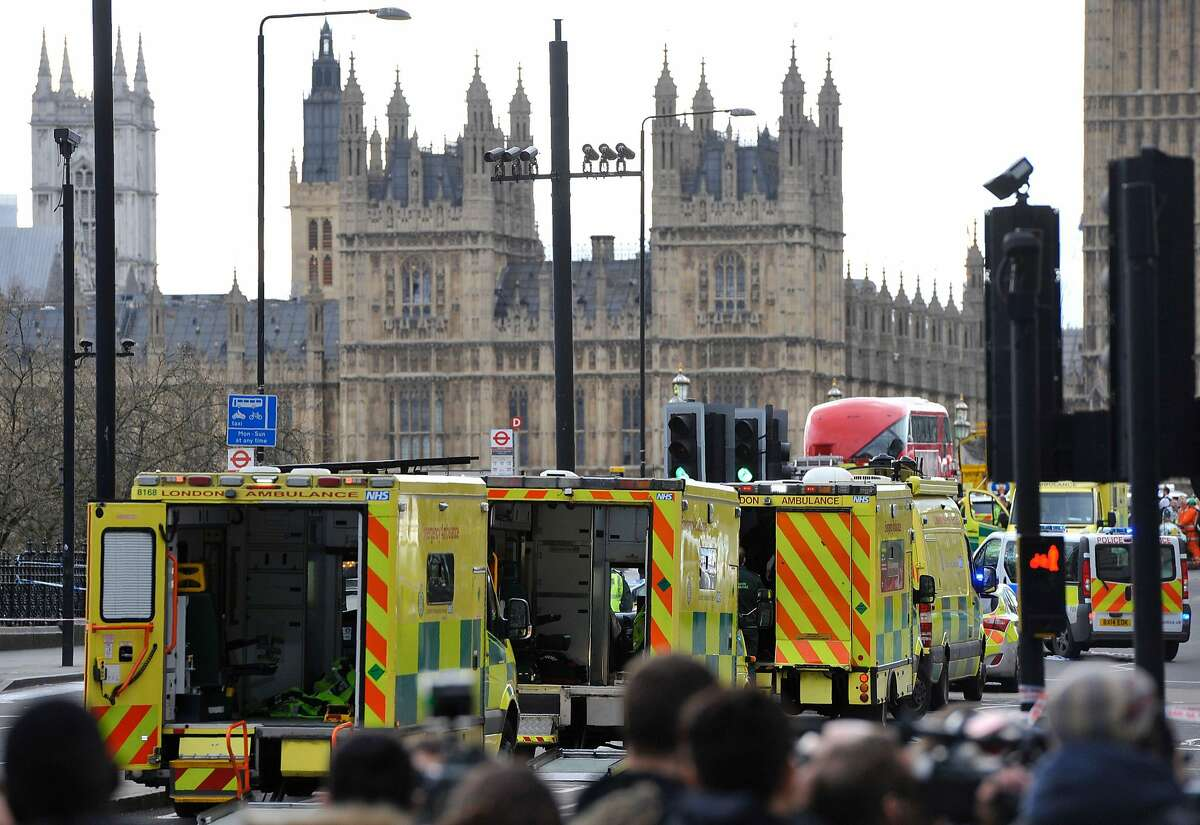 """Ambulances wait as members of the emergency services work on Westminster Bridge, alongside the Houses of Parliament in central London on March 22, 2017, during an emergency incident. British police shot a suspected attacker outside the Houses of Parliament in London on Wednesday after an officer was stabbed in what police said was a """"terrorist"""" incident. One woman has died and others have """"catastrophic"""" injuries following a suspected terror attack outside the British parliament, local media reported on Wednesday citing a junior doctor. / AFP PHOTO / NIKLAS HALLE'NNIKLAS HALLE'N/AFP/Getty Images"""