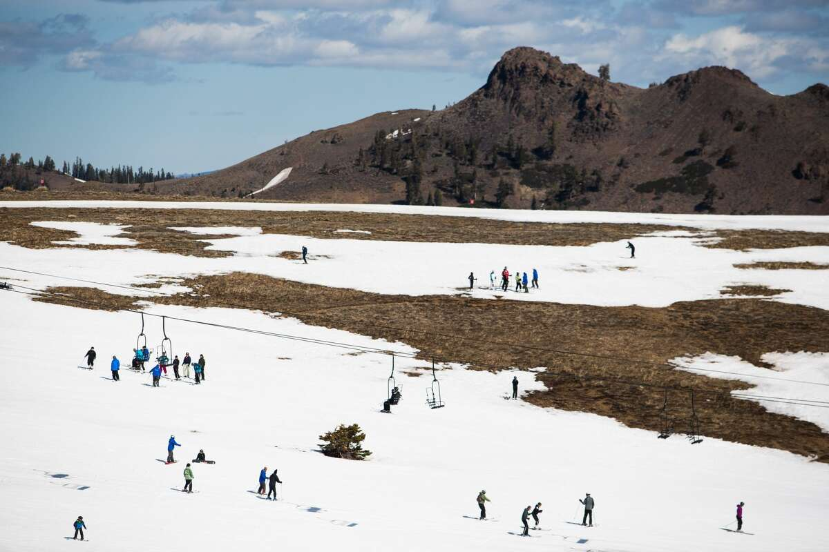 Squaw Valley March 2015 Skiers slalom through patches of dry ground at Squaw Valley Ski Resort, March 21, 2015, in Olympic Valley, Calif. Many Tahoe-area ski resorts closed early due to low snowfall as California's historic drought continued.