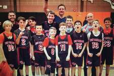 The New Canaan sixth grade Black team poses after winning the FCBL A Division championship.