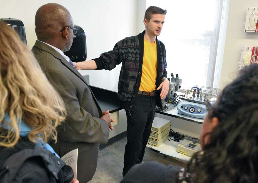 Biology and business major Benjamin Rouse of Schenectady gives a tour of new facilities during the opening of Schenectady County Community College's new biotechnology laboratory and research facility Wednesday March 22, 2017 in Schenectady, NY. (John Carl D'Annibale / Times Union)