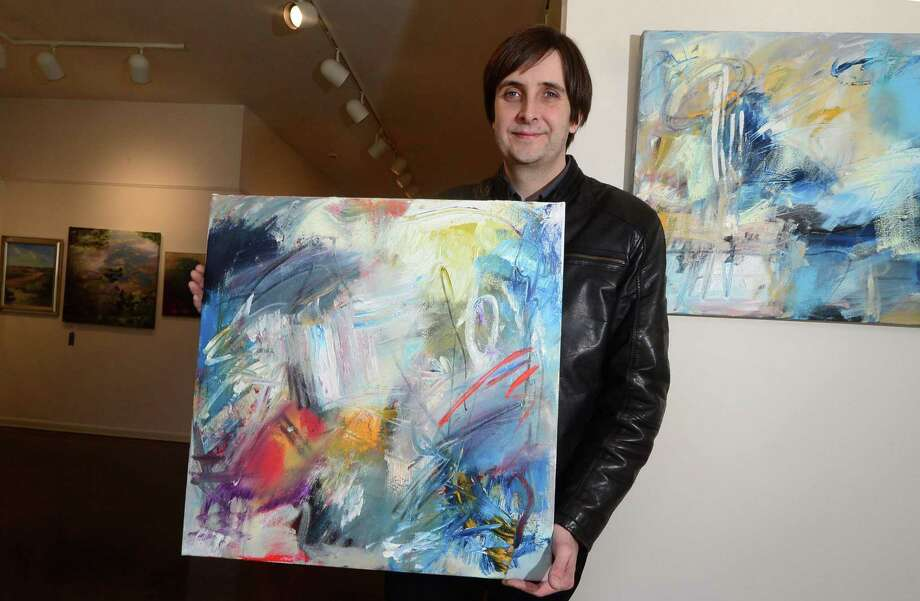 Artist Bruce Horan with two of his abstract paintings Wednesday, March 22, 2017, that will be featured in the upcoming Rowayton Arts Center Abstraction – Abstracts exhibit that opens April 2nd at the Center in Norwalk, Conn. The Norwalk Arts Commission, in partnership with the Rowayton Arts Center will host this year's SLOW Art Day program on April 8th from 10 AM – 12 PM at the Center where Riad Miah, an award-winning New York artist and educator, will lead participants in a conversation about artwork he judged for RAC's Abstraction – Abstracts exhibit. Slow Art Day is a global event where people all over the world visit local museums and galleries to look at five works of art for 10 minutes each and then meet to discuss their experience. Photo: Erik Trautmann / Hearst Connecticut Media / Norwalk Hour