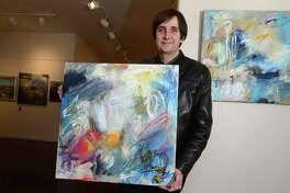 Artist Bruce Horan with two of his abstract paintings Wednesday, March 22, 2017, that will be featured in the upcoming Rowayton Arts Center Abstraction – Abstracts exhibit that opens April 2nd at the Center in Norwalk, Conn. The Norwalk Arts Commission, in partnership with the Rowayton Arts Center will host this year's SLOW Art Day program on April 8th from 10 AM – 12 PM at the Center where Riad Miah, an award-winning New York artist and educator, will lead participants in a conversation about artwork he judged for RAC's Abstraction – Abstracts exhibit. Slow Art Day is a global event where people all over the world visit local museums and galleries to look at five works of art for 10 minutes each and then meet to discuss their experience.