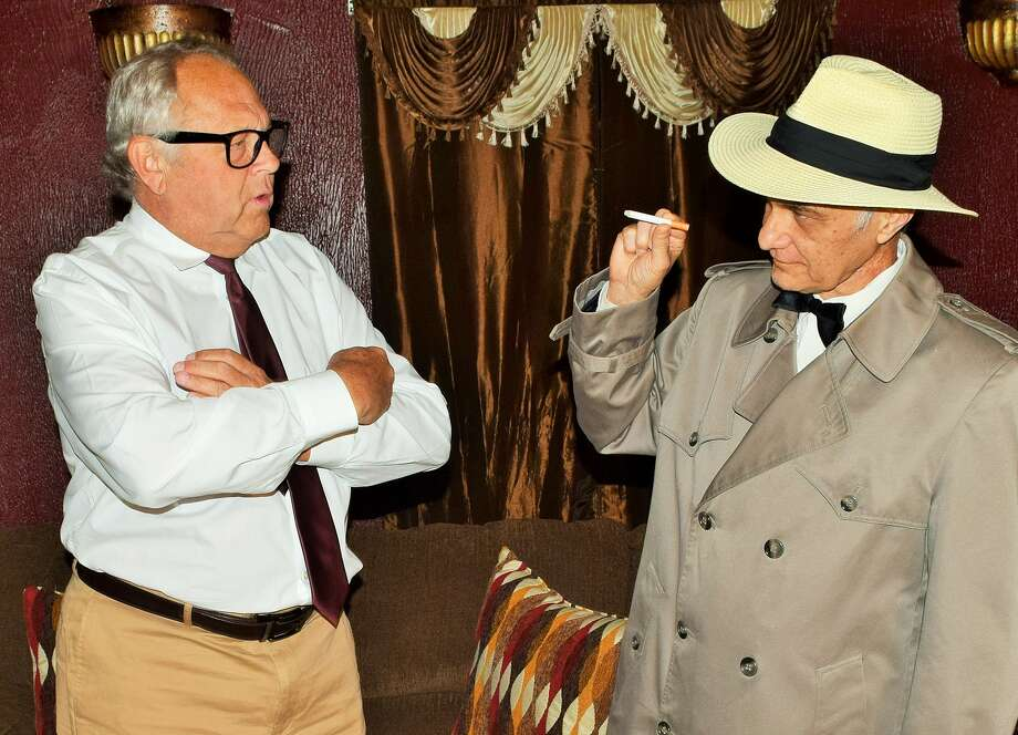 "John Lofaro, right, plays the ghost of tough-guy Humphrey Bogart in a dinner theater production of Woody' Allen's comedy ""Play It Again, Sam."" Steve Quimby, right, portrays a recent divorcé taking tips from Bogey on how to attract women."