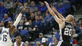 Spurs' Manu Ginobili shoots over the Minnesota Timberwolves' Shabazz Muhammad during the second half on March 21, 2017, in Minneapolis. The Spurs won 100-93.