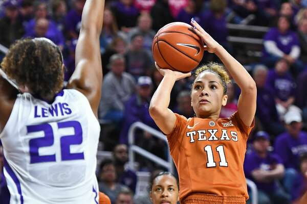 MANHATTAN, KS - FEBRUARY 27:  Guard Brooke McCarty #11 of the Texas Longhorns shoots the ball against forward Breanna Lewis #22 of the Kansas State Wildcats during the first half on February 27, 2017 at Bramlage Coliseum in Manhattan, Kansas.  Texas defeated Kansas State 69-61. (Photo by Peter G. Aiken/Getty Images)