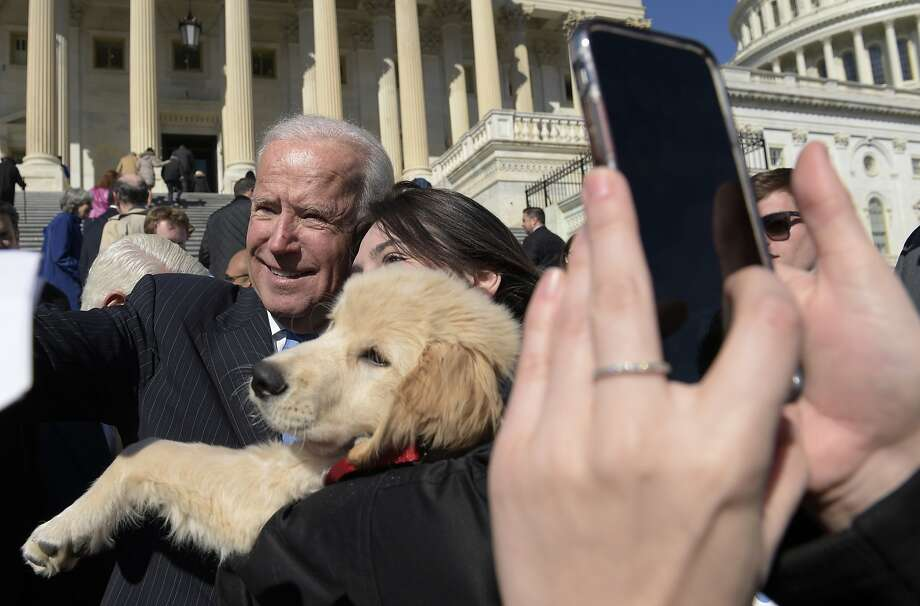 Former Vice President Joe Biden poses for a photo as he greets the crowd on Capitol Hill in Washington, Wednesday, March 22, 2017, following an even marking seven years since former President Barack Obama signed the Affordable Care Act into law. (AP Photo/Susan Walsh) Photo: Susan Walsh, Associated Press