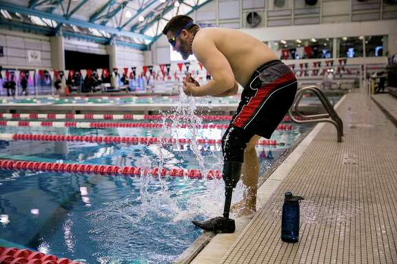 Dan Lasko tests out a new prosthetic leg designed to go from walking on land to swimming in water at the Nassau County Aquatic Center in East Meadow, N.Y., Feb. 22, 2017. While waterproof prosthetic legs have been available for decades, the prototype Lasko is testing stands to be the first fully functional swim leg. (Sam Hodgson/The New York Times)