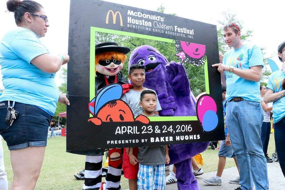 Young fans take a photo with McDonald's The Hamburglar and Grimace at the 2016 McDonald's Houston Children's Festival. This year's event is set for April 1-2 in downtown Houston.