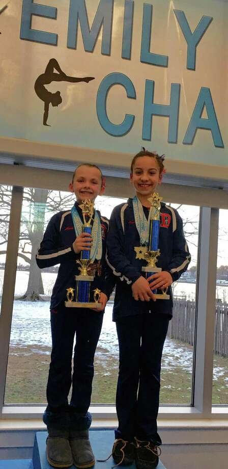 Taking first All Around for their age groups at the Emily Fedorko Challenge were Ava Licata of New Canaan and Darien YMCA gymnastic's teammate Tanner Generoso. Photo: Contributed Photo / New Canaan News contributed