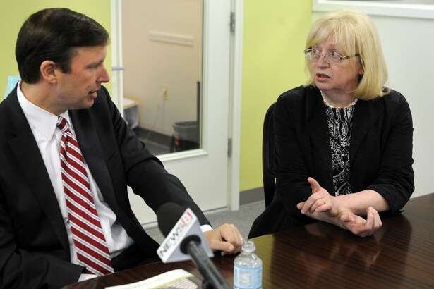 U.S. Sen. Chris Murphy in May 2014 with Joan Carty, CEO of the Housing Development Fund, in Bridgeport, Conn.