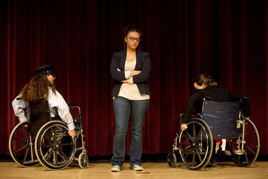 "From left, Sophien Wirtz, Lila Granroth and Kelsie Miller act during rehearsal for ""Fully Accessible"" on Tuesday at Bullock Creek High School. ""Black Comedy"" opens Thursday, Mar. 23 at 7 p.m. with additional performances on Friday, Mar. 24 at 7 p.m. and Saturday, Mar. 25 at 3 p.m. In addition to ""Black Comedy,"" the ensemble will put on three 10-minute pieces directed by students. Photo: Erin Kirkland/Midland Daily News"