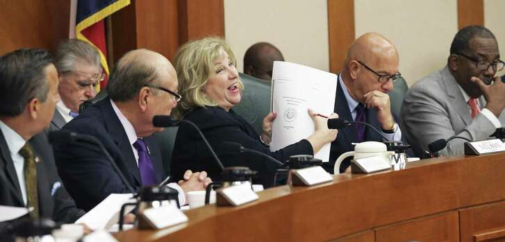 Chairman Senator Jane Nelson gleefully hoists the large volume which is the final draft as the Texas Senate Finance Committee votes out its version of the state spending plan for the next two years on March 22, 2017.