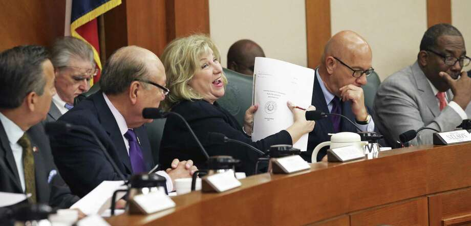 Chairman Senator Jane Nelson gleefully hoists the large volume which is the final draft as the Texas Senate Finance Committee votes out its version of the state spending plan for the next two years on March 22, 2017. Photo: Tom Reel, Staff / San Antonio Express-News / 2017 SAN ANTONIO EXPRESS-NEWS