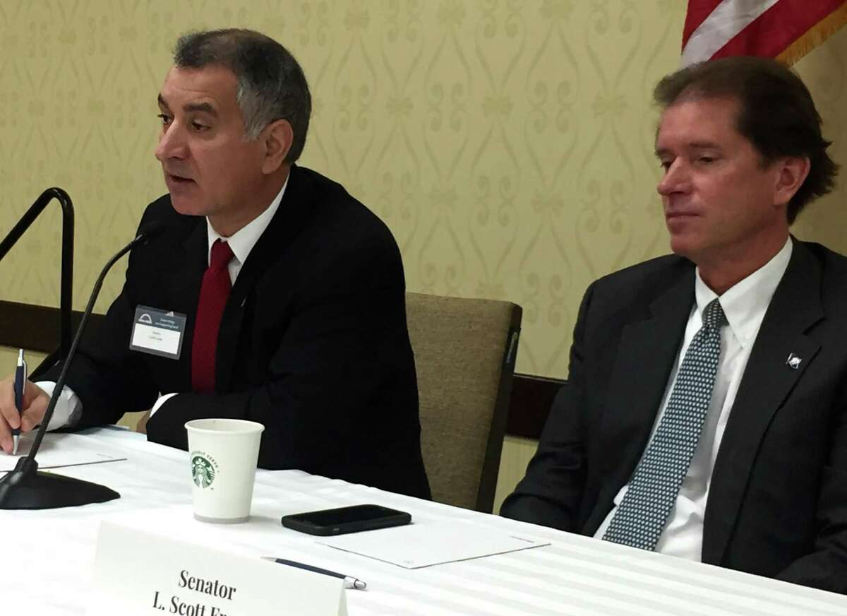 State Sen. Carlo Leone, D-27, and state Sen. L. Scott Frantz, R-36, discuss Connecticut's fiscal challenges during a legislative breakfast, organized by the Stamford Chamber of Commerce, at the Stamford Sheraton hotel, on Wednesday, March 22, 2017.
