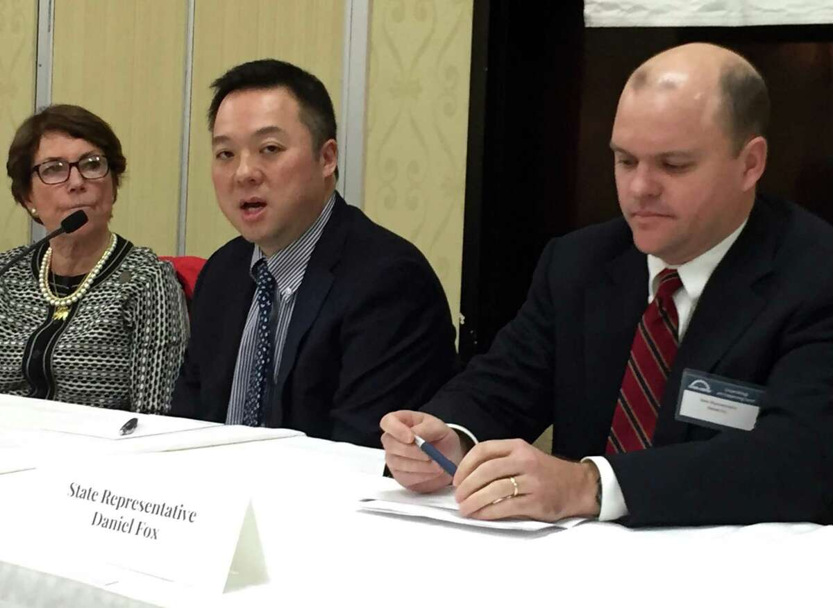 State Rep. William Tong, center, D-147, state Rep. Livvy Floren, R-149, and state Rep. Daniel Fox, D-148, discuss Connecticut's fiscal challenges during a legislative breakfast, organized by the Stamford Chamber of Commerce, at the Stamford Sheraton hotel, on Wednesday, March 22, 2017.