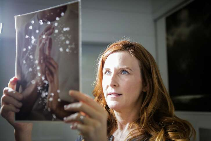 Tabitha Soren shows off a photograph while giving a tour of her studio in Berkeley, California, on Wednesday, March 22, 2017.