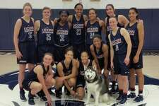 UConn's mascot, Jonathan the Husky, seen with the women's basketball team. Photo courtesy of the Jonathan the Husky Facebook page.