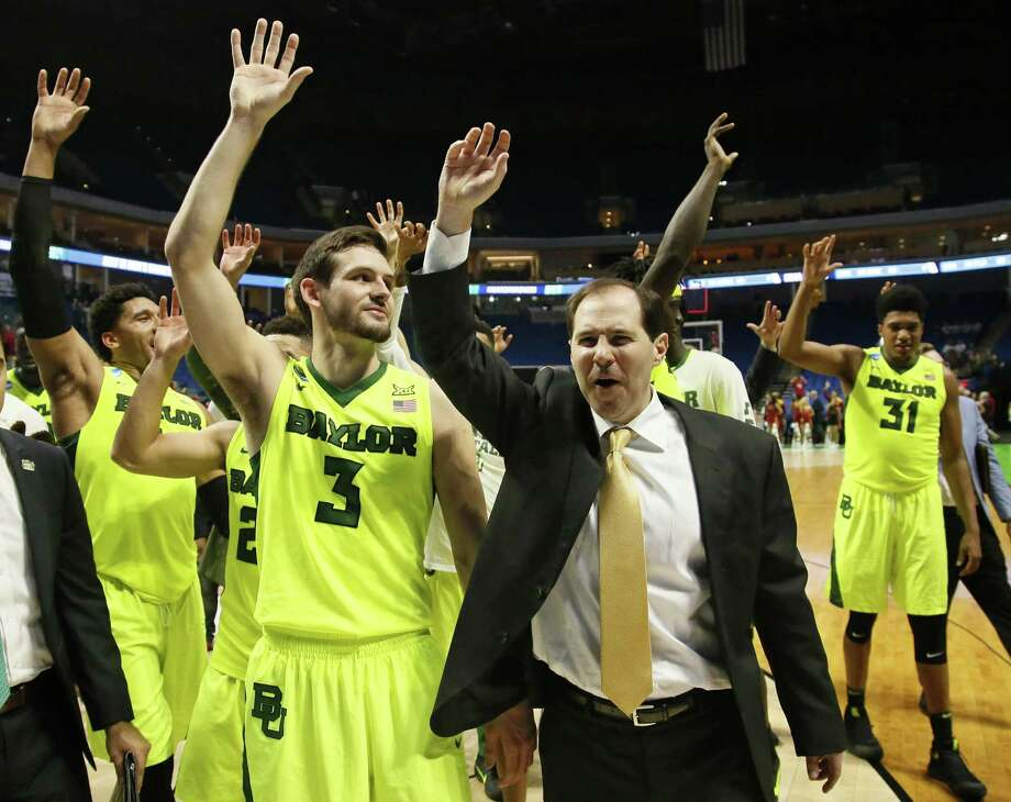 Baylor coach Scott Drew and his team wave to fans following a second-round game against Southern California in the NCAA Tournament in Tulsa, Okla., on March 19, 2017. Baylor won 82-78. Photo: Sue Ogrocki /Associated Press / AP2017