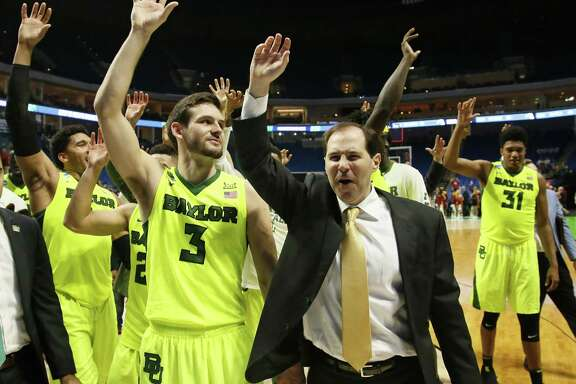 Baylor coach Scott Drew and his team wave to fans following a second-round game against Southern California in the NCAA Tournament in Tulsa, Okla., on March 19, 2017. Baylor won 82-78.