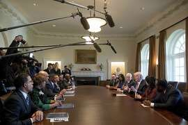 President Donald Trump and Vice President Mike Pence meets with members of the Congressional Black Caucus Wednesday, March 22, 2017, in the Cabinet Room of the White House in Washington. (AP Photo/Andrew Harnik)