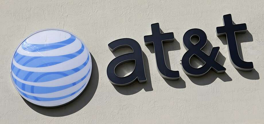 FILE - This Wednesday, Feb. 8, 2017, file photo shows the AT&T sign at a store in Hialeah, Fla. Some 17,000 AT&T workers in California and Nevada have gone on strike, the union said Wednesday, March 22, 2017. The workers install cable and phone service and work in call centers where customers can phone in with questions and problems. (AP Photo/Alan Diaz, File) Photo: Alan Diaz, Associated Press
