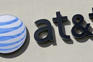 FILE - This Wednesday, Feb. 8, 2017, file photo shows the AT&T sign at a store in Hialeah, Fla. Some 17,000 AT&T workers in California and Nevada have gone on strike, the union said Wednesday, March 22, 2017. The workers install cable and phone service and work in call centers where customers can phone in with questions and problems. (AP Photo/Alan Diaz, File)