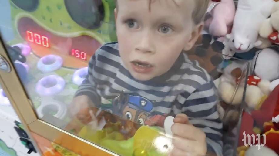 3-year-old boy who gets into everything climbs into arcade toy machine