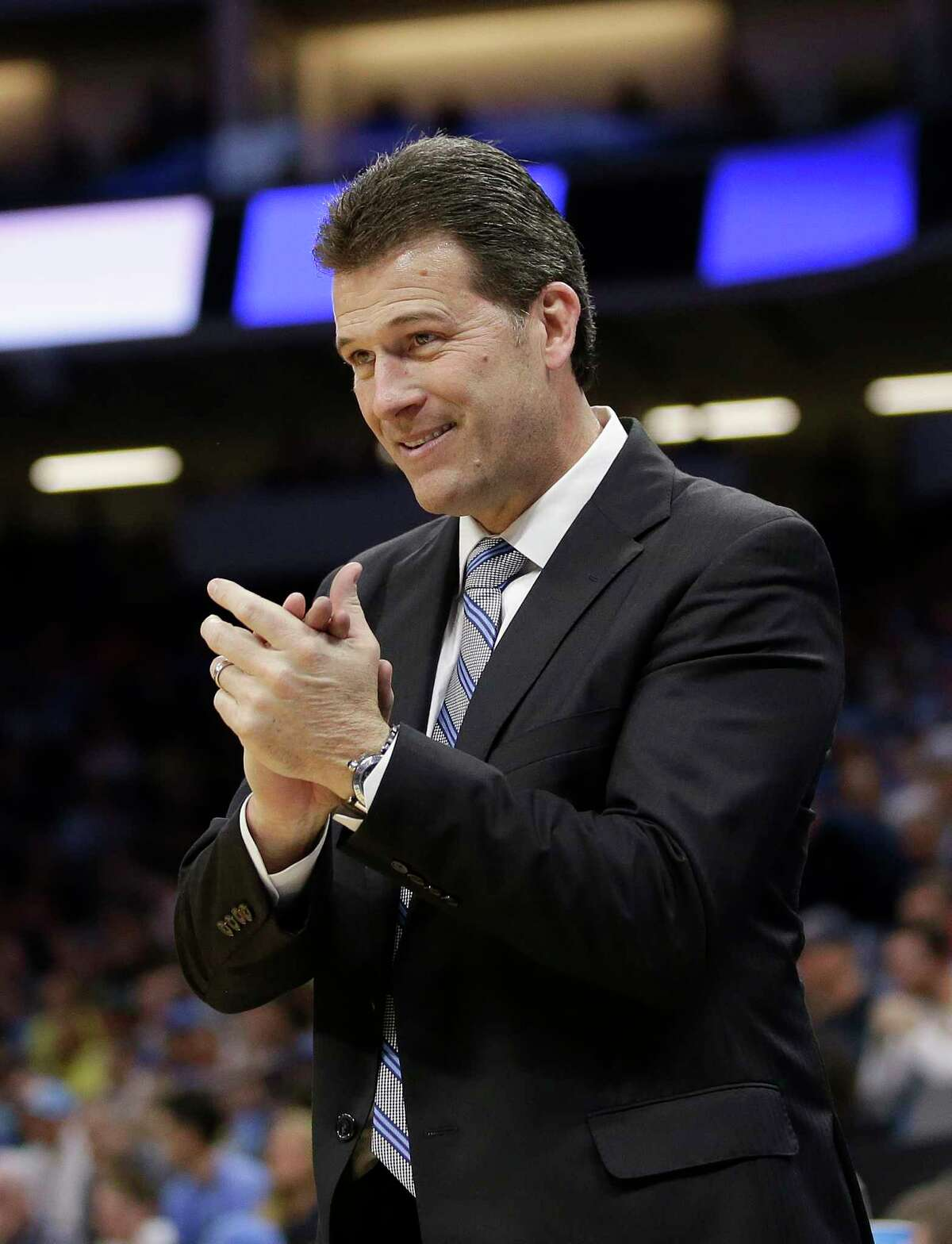 UCLA head coach Steve Alford applauds his team in the closing moments of their 79-67 win over Cincinnati in a second-round game of the NCAA men's college basketball tournament in Sacramento, Calif., Sunday, March 19, 2017. (AP Photo/Rich Pedroncelli)