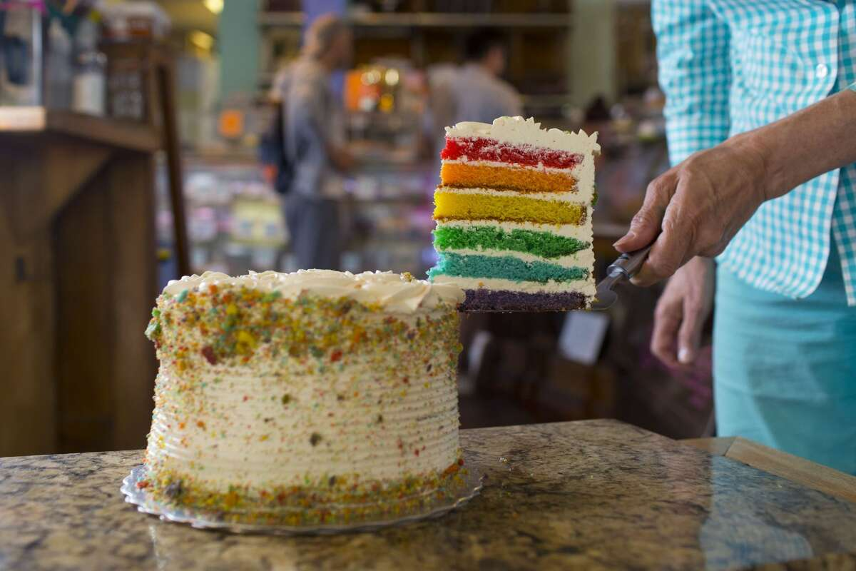 TORONTO, ON - JUNE 1, 2016: Wanda Beaver of Wanda's Pie in the Sky shows off the pride month themed cookies, rainbow cakes and cup cakes being sold from the shop in Kensington Market. Pride month in Toronto started June 1. (Chris So/Toronto Star via Getty Images)