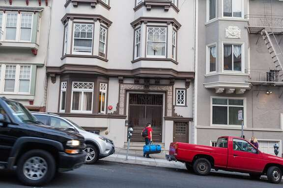 A man with luggage outside of 1669 Sacramento Street after being dropped off by an airport shuttle in San Francisco, Calif., Wednesday, June 10, 2015. Five people live in the Nob Hill victorian flat but complain that their landlady is renting units above and below on Airbnb, violating city codes, creating a nuisance and a security risk for longterm tenants.