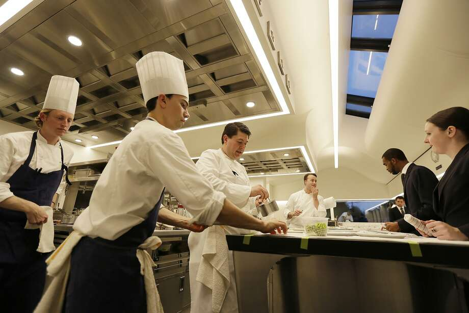 """The kitchen at the French Laundry in Yountville. The restaurant said that when it comes to stages, it """"work(s) diligently to ensure compliance to all state and federal employment laws."""" Photo: Eric Risberg, Associated Press"""