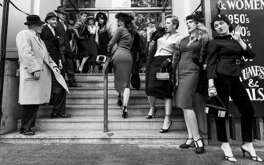 Decades of Fashion owner Cicely Hansen (second from right) climbing the stairs of her store on Haight Street in a 1940s ensemble from her personal collection. Photo: Courtesy Of Cicely Hansen
