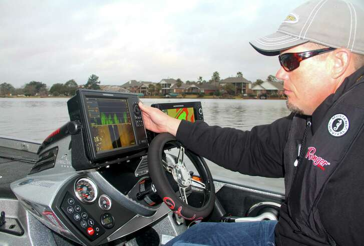 Professional bass tournament angler Keith Combs uses some of his boat's extensive marine electronics to help locate potential fishing areas while scouting Lake Conroe, site of the 2017 Bassmaster Classic world bass fishing championship this March.