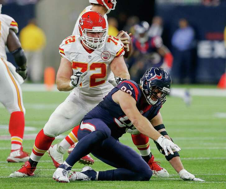 HOUSTON, TX - JANUARY 09:  J.J. Watt #99 of the Houston Texans is blocked by Eric Fisher #72 of the Kansas City Chiefs during the AFC Wild Card Playoff game  at NRG Stadium on January 9, 2016 in Houston, Texas.  (Photo by Bob Levey/Getty Images)