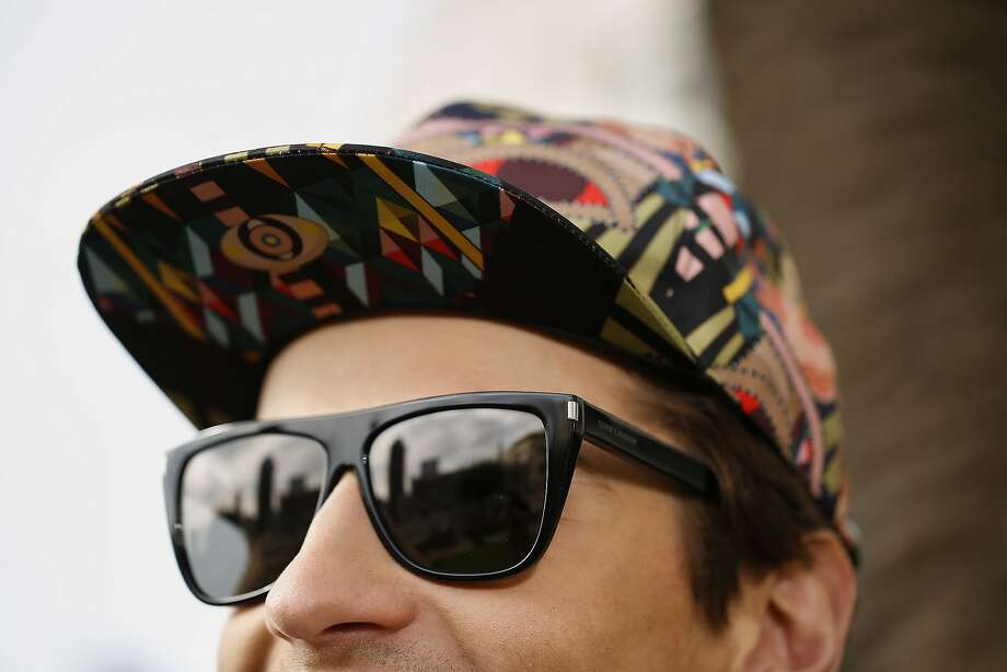 "Givenchy ""Cleopatra"" print hat $495, and Saint Laurent sunglasses, $360, Barneys New York Men's Store, S.F. Photo: Russell Yip, The Chronicle"