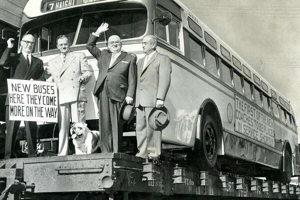 1950's: First new fleet of 440 buses rolled over the city streets. The 48 passenger buses were leased from the Mack Truck Corporation of Allentown, PA. Left to right are PUC Manager James H. Turner, Mack district manager Jack Donovan, Mayor Elmer E. Robinson and Controller Harry D. Ross. The bulldog is the firm's trademark. November 3, 1955