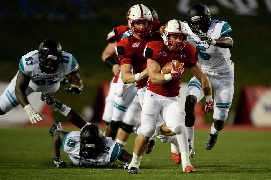 Lamar running back Kade Harrington (8) breaks free for a touchdown run in the first quarter against Coastal Carolina at Provost Umphrey Stadium on Saturday evening.  Photo taken Saturday 9/3/16 Ryan Pelham/The Enterprise Photo: Ryan Pelham / ©2016 The Beaumont Enterprise/Ryan Pelham