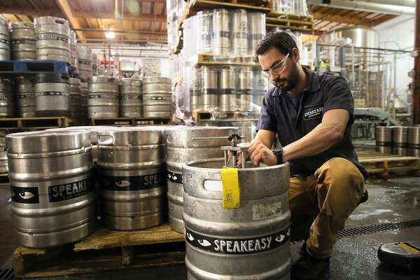 Brewer Clay Jordan, at the Speakeasy Ales & Lagers Brewery in San Francisco , Ca. as seen on Wed. March 22, 2017. The brewery announced it was closing two weeks ago, then started brewing again at full speed as it looks for a buyer.
