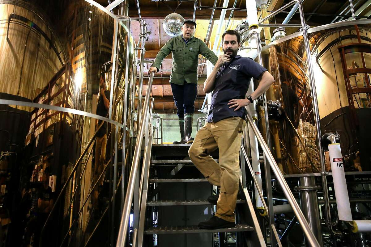 Brewers Josh Benedict, (top) and Clay Jordan at the Speakeasy Ales & Lagers Brewery in San Francisco , Ca. as seen on Wed. March 22, 2017. The brewery announced it was closing two weeks ago, then started brewing again at full speed as it looks for a buyer.
