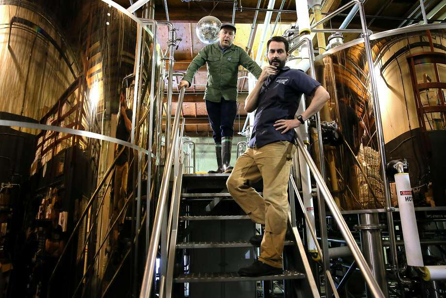 Josh Benedict (top) and Clay Jordan at Speakeasy Ales in S.F., which shut down in 2017 and was subsequently sold. Its taproom reopened in December under new owner Ces Butner. Photo: Michael Macor, The Chronicle