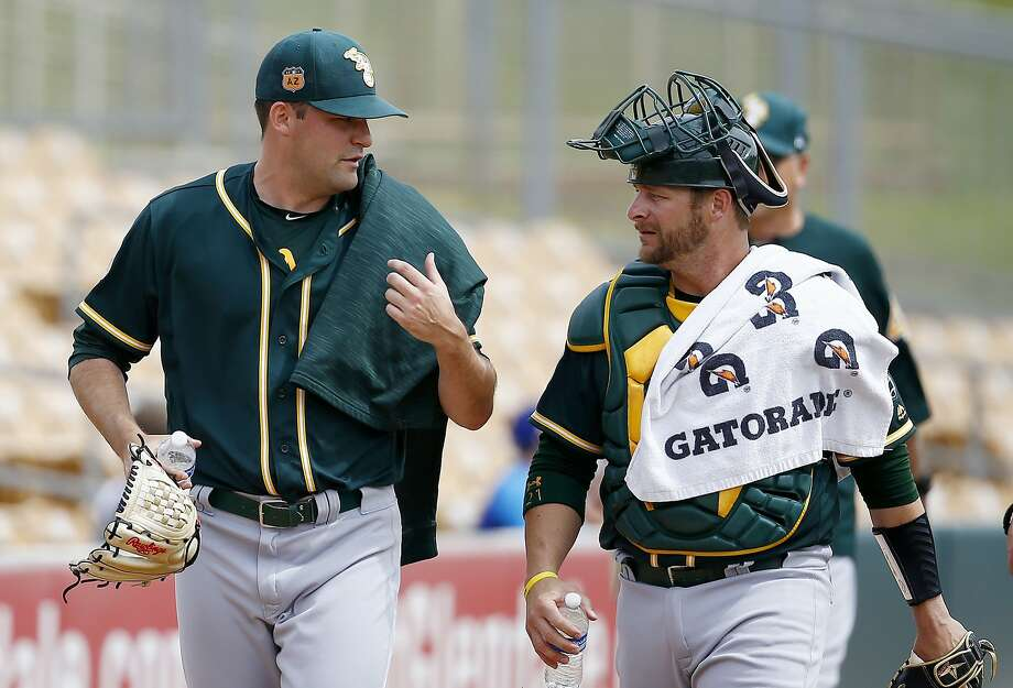 Oakland Athletics pitcher Andrew Triggs, left, talks with catcher Stephen Vogt after warming up in the bullpen prior to a spring training baseball game against the Chicago White Sox, Wednesday, March 22, 2017, in Glendale, Ariz. (AP Photo/Ross D. Franklin) Photo: Ross D. Franklin, Associated Press