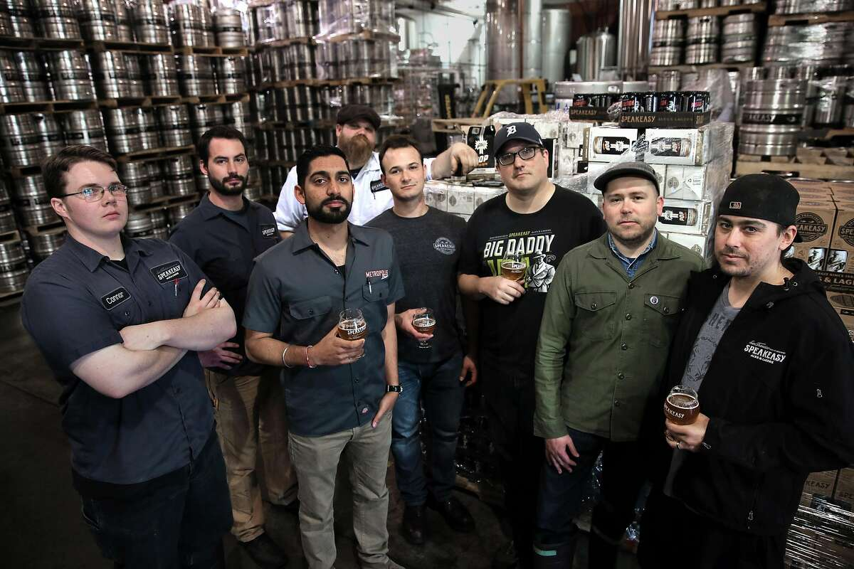 During the transition period before the sale to Hunters Point Brewery, Speakeasy's staff was down to eight. From left: cellar worker Connor Bross, brewer Clay Jordan, controller Raman Sharma, cellar worker Rick Schmidt, supply chain manager Andrew Swatzell, public relations director Brian Stechschulte, brewer Josh Benedict and cellar worker Zack Farwell.