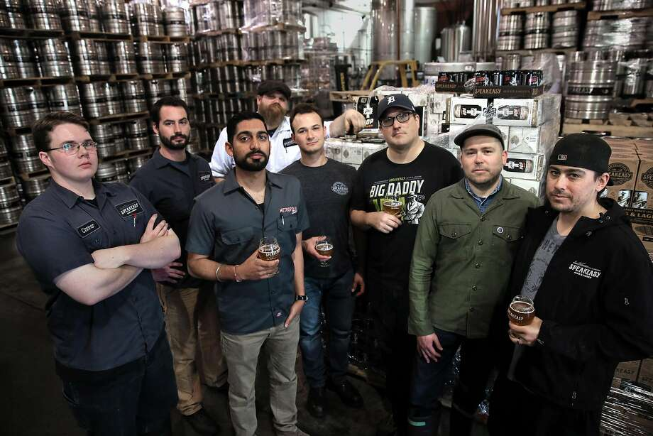 During the transition period before the sale to Hunters Point Brewery, Speakeasy's staff was down to eight. From left: cellar worker Connor Bross, brewer Clay Jordan, controller Raman Sharma, cellar worker Rick Schmidt, supply chain manager Andrew Swatzell, public relations director Brian Stechschulte, brewer Josh Benedict and cellar worker Zack Farwell. Photo: Michael Macor, The Chronicle