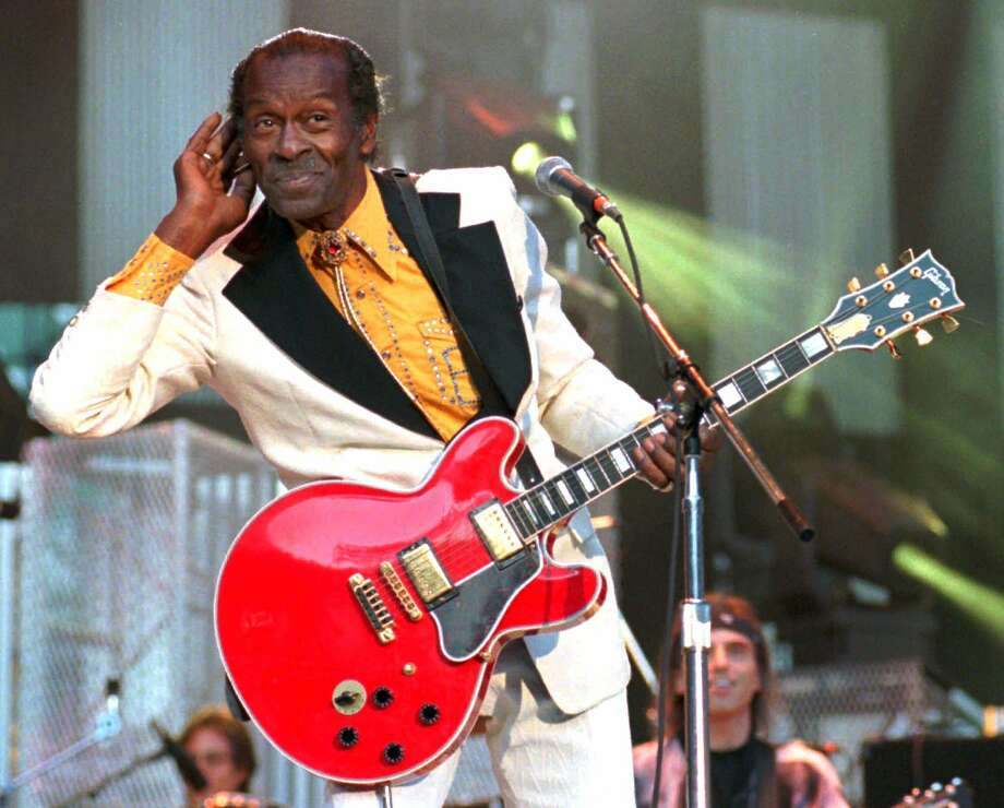 Rock 'n' roll legend Chuck Berry listens for the crowd to sing to him during a performance of his hit song 'Johnny B. Goode,' at the Concert for the Hall of Fame in Cleveland, in this Sept. 2, 1995, file photo. Berry died Saturday. Photo: MARK DUNCAN /AP / AP