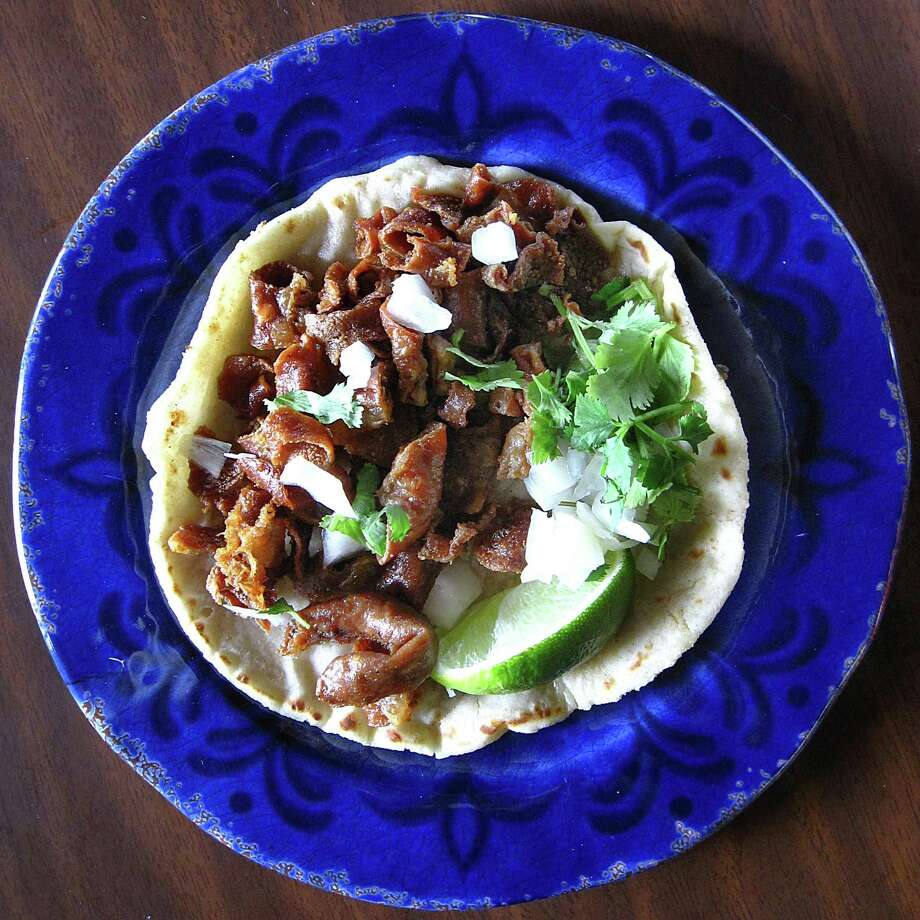 Crispy tripas taco on a handmade corn tortilla from Andrea's Mexican Restaurant on SW Loop 410. Photo: Mike Sutter /San Antonio Express-News